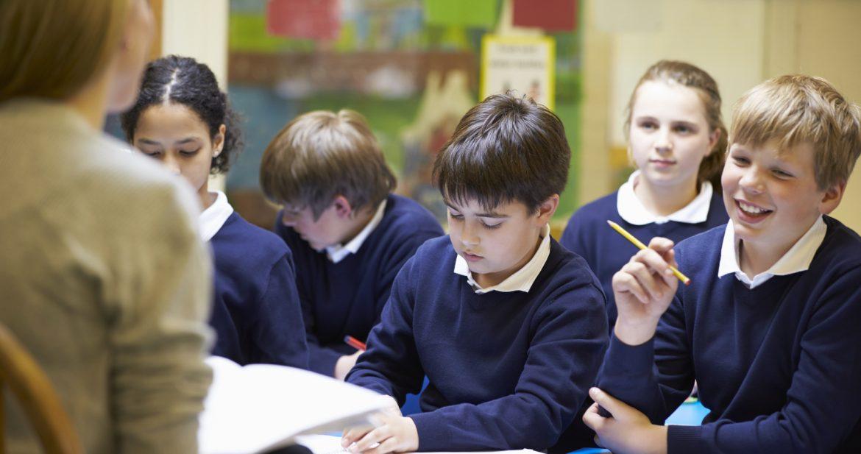 eacher Teaching Lesson To Elementary School Pupils
